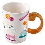 This quality ceramic drinking mug would make a great addition for any hobbiest! The tape measure handle design is a great conversation piece!  Holds 40ml / 13.5 fl. oz. and is microwave and dishwasher safe. Available in assorted colours. Item dimensions: Packaged in a colourful, windowed box measuring 15 x 10 x 12cm (5<sup>7</sup>⁄<sub>8</sub>″ x 3<sup>7</sup>⁄<sub>8</sub>″ x 4<sup>3</sup>⁄<sub>4</sub>″) and 345g (0.76 lb)
