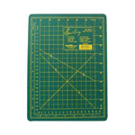 3 ply cutting mat allows you to use both sides for cutting. Green mat with yellow markings.
