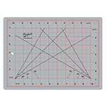 Self healing, grey, 9″ x 12″ cutting mat with red and black markings. 3 ply grey mat. non-slip foam back for cutting in a stationary position. Self healing mat also protects and extends the life of cutting tools. 1″ grid (red) with <sup>1</sup>⁄<sub>8</sub>″ markings (black). Convenient 30°, 45° and 60° markings printed on mat. Imperial measurements. Mat: 8 3/4″ x 11 3/4″ (22 x 30 cm). Grid: 8″ x 11″ (20 x 28 cm)